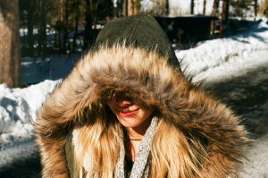 Girl in fur coat, clothing is not cheap in Russia by Nick Monica