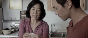 David Au's Eat With Me Film starring Sharon Omi. Woman folds dumplings.